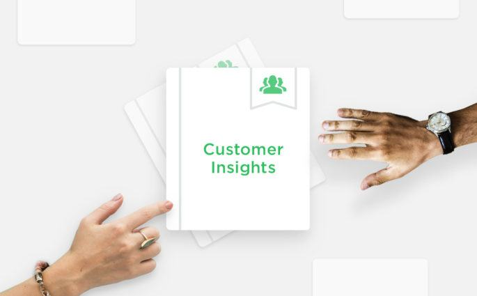 Two Hands over Customer Insights Documents