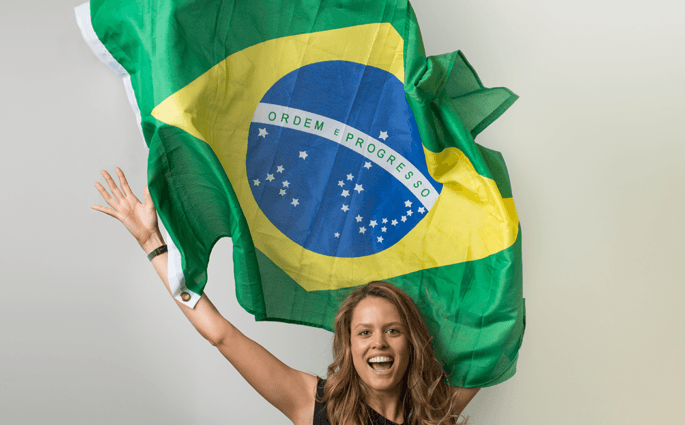 Julia Figueiredo with a Brazilian Flag