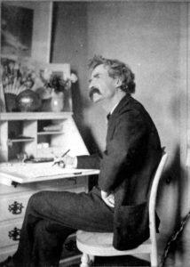 Mark Twain Sitting on Chair Thinking