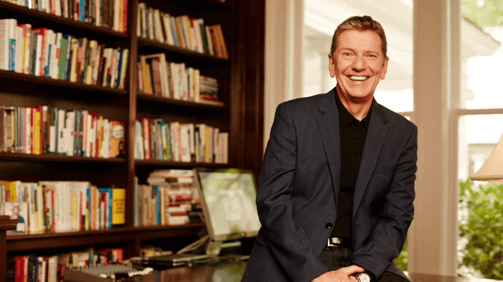 Photo of Michael Hyatt with a bookcase behind him