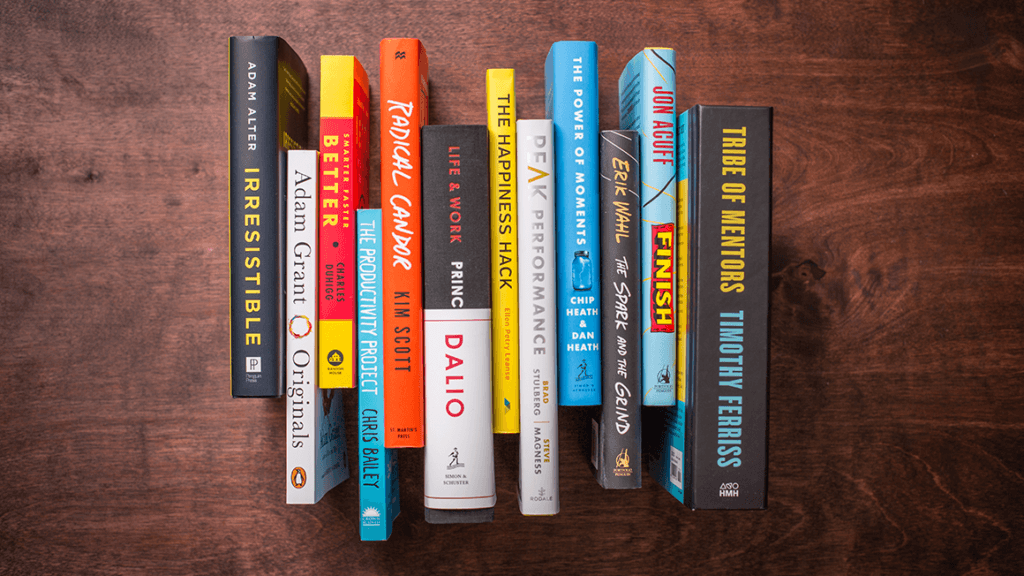12 books on a wooden surface