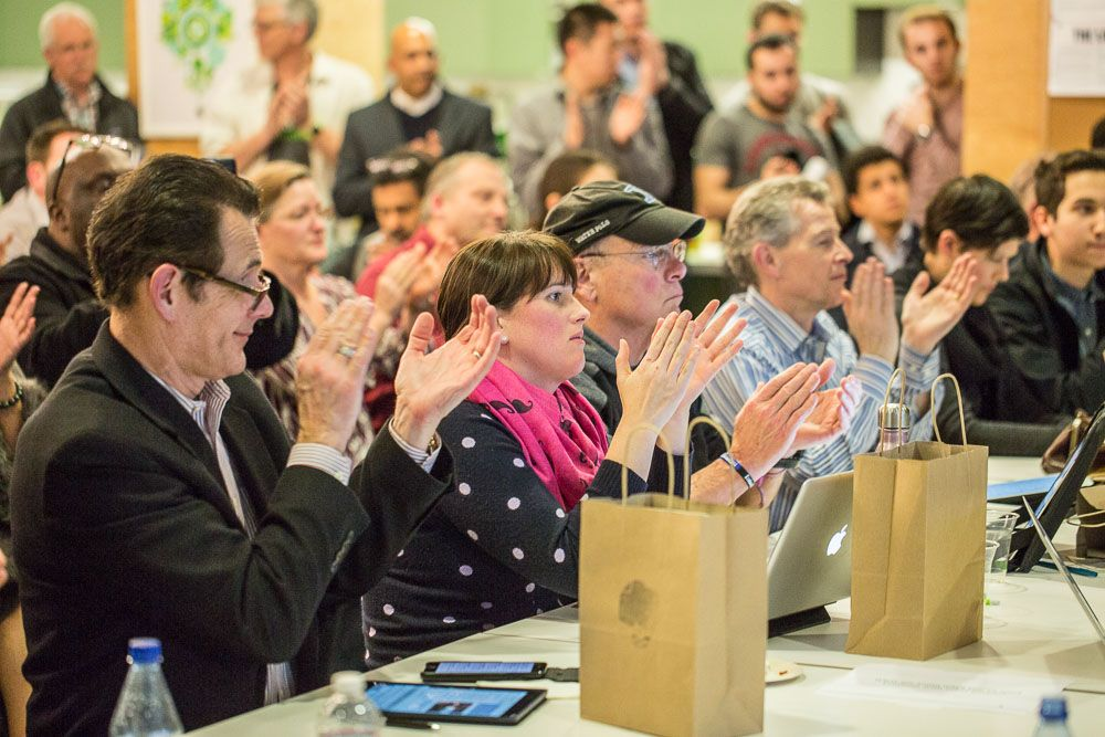 People Clapping next to Evernote Bags at Evernote HQ