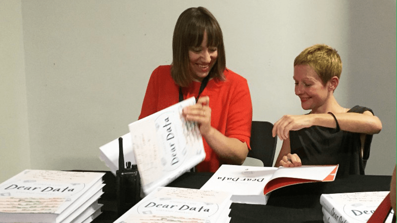 Giorgia signing a book