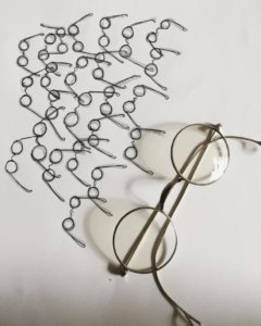 Glasses next to drawings of glasses