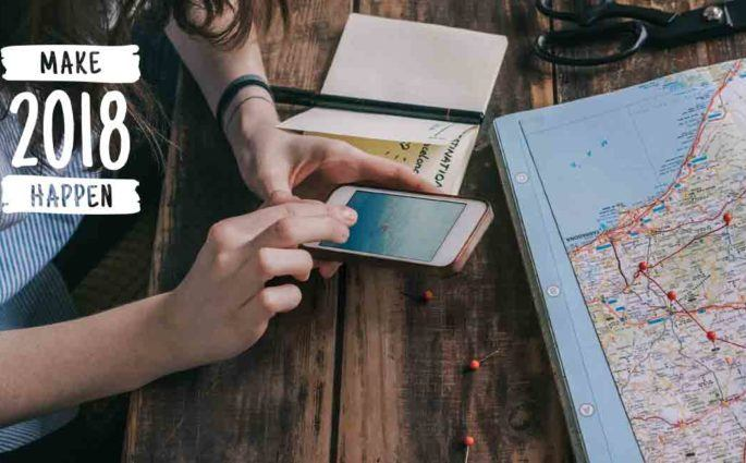 Hands holding Smartphone next to map