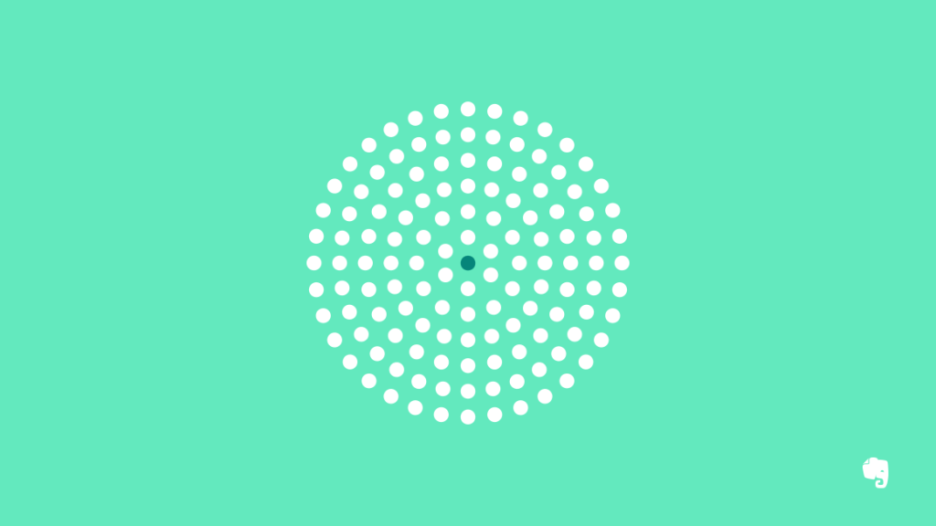 Black Dot Surrounded by White Dots Illustrating Minimalism