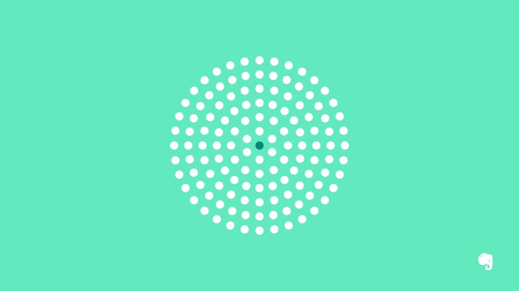 Black Dot Surrounded by White Dots Illustrating Minimalism